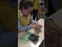 550 купюр за 77 секунд: кассир из Китая считает деньги