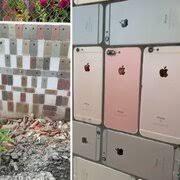 На зависть миллиардерам: житель Вьетнама облицевал свой забор «айфонами» вместо плитки