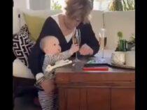 Женщина на видео спасла бокал с вином и уронила внука
